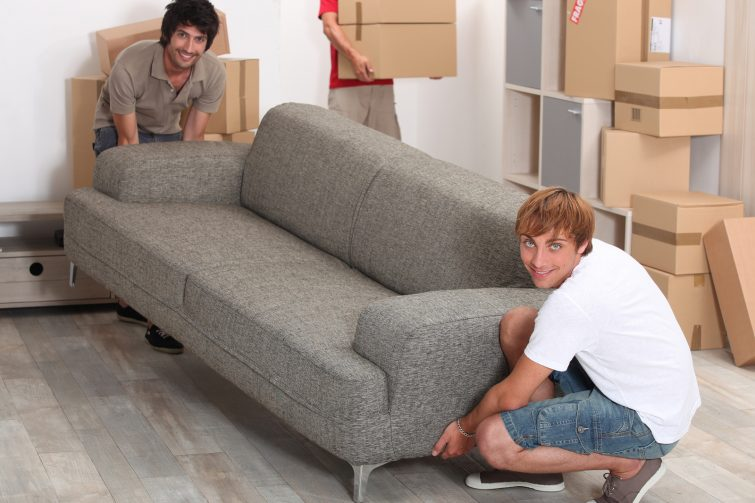 bigstock-Men-lifting-sofa-22063970